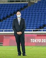 YOKOHAMA, JAPAN - AUGUST 6: President of FIFA Gianni Infantino awaits the athletes during the medal ceremony at International Stadium Yokohama on August 6, 2021 in Yokohama, Japan.