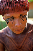 Posto Leonardo, Xingu, Brazil. Man with hair dyed with red Urucum paste and black genipapo body paint.