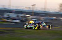 "Rolex 24 at Daytona, Daytona International Speedway 5/6 Feb, 2005.P.L.N. suffers an ""off"" at the West Horseshoe Saturday at dusk..Copyright©F.Peirce Williams 2005"