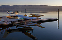 Seaplanes docked at the Skylark Shores Resort at dawn during the Clear Lake Splash-In, Lakeport, California, Lake County, California including N461BD, a Cessna 172N on floats in the foreground, N8516M, a 182 SeaLane in the background, and a Super Cub on floats.