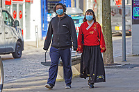 Pictured: A young couple wearing face masks in the city centre of Swansea, Wales, UK. Wednesday 25 March 2020 <br /> Re: Covid-19 Coronavirus pandemic, UK.
