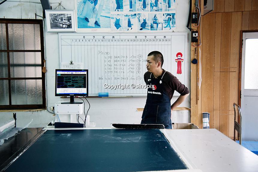 MAY 15, 2014 - KOJIMA, KURASHIKI, JAPAN: worker at the Betty Smith's factory. (Photograph / Ko Sasaki)