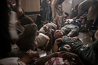 In this Wednesday, Aug. 14, 2013 photo, wounded supporters of the ousted president Mohammed Morsi lay down on the floor at a field hospital during clashes with security forces in streets around Al-Raba'a Alawya mosque in the Nasr district of Cairo. (Photo/Narciso Contreras).