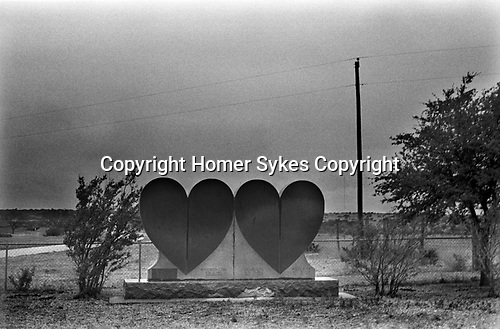 Double Heart Ranch Sweetwater Texas. Double Heart shaped tomb stones in memory of members of the Cox family positioned at the boundary fence of their ranch. 1999 1990s