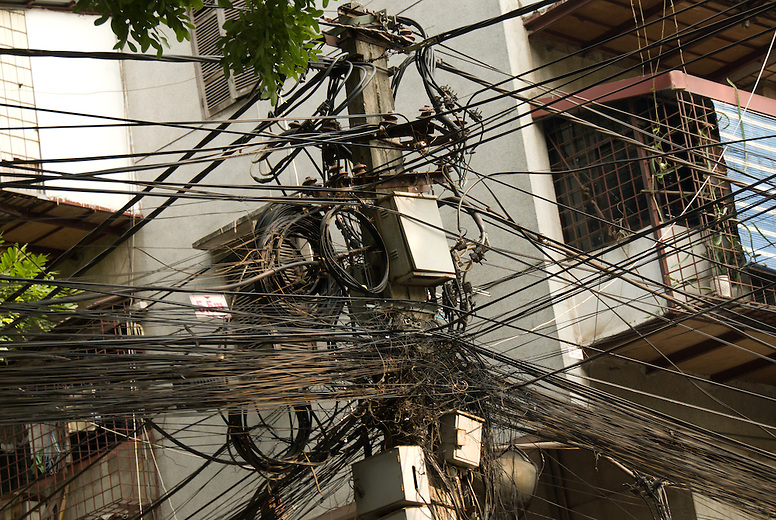 Despite its breakneck pace of industrialization, electrical poles in Hanoi, Vietnam show there is still room for modernization.
