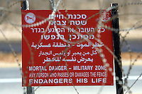 A warning sign at the new fence September 22, 2003.Photo by Quique Kierszenbaum..