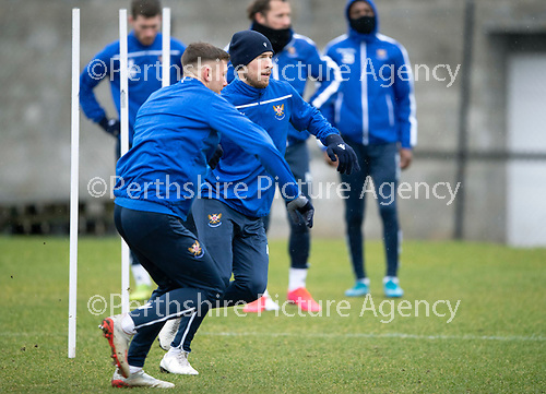 St Johnstone Training…….14.02.20<br />David Wotherspoon pictured racing against Callum Hendry during this morning's training session at McDiarmid Park ahead of tomorrows game against Ross County.<br />Picture by Graeme Hart.<br />Copyright Perthshire Picture Agency<br />Tel: 01738 623350  Mobile: 07990 594431