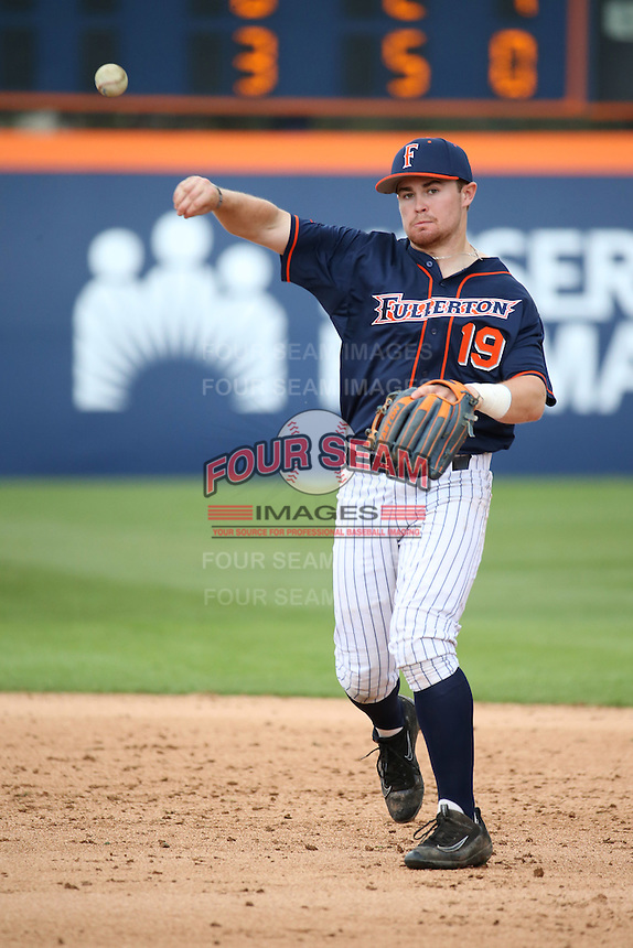 Dillon Persinger #19 of the Cal State Fullerton Titans makes a throw during a game against the Stanford Cardinal at Goodwin Field on February 19, 2017 in Fullerton, California. Stanford defeated Cal State Fullerton, 8-7. (Larry Goren/Four Seam Images)