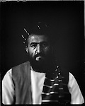 "HajjiAgha Lalai, a tribal elder and member of the Kandahar Provincial Council, is seen at his home in Kabul, 30 August 2012. This portrait was shot on a 5x4 Linhof Technika IV, circa 1959, and a Schneider Kreuznach 270mm lens, circa 1952, with front tilt, and is part of a series entitled ""Putting an Afghan face on the war."" (John D McHugh)"
