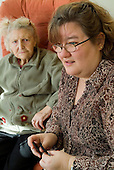 Manager Babs Doran with residents of a Westminster Council sheltered housing scheme in Paddington, London