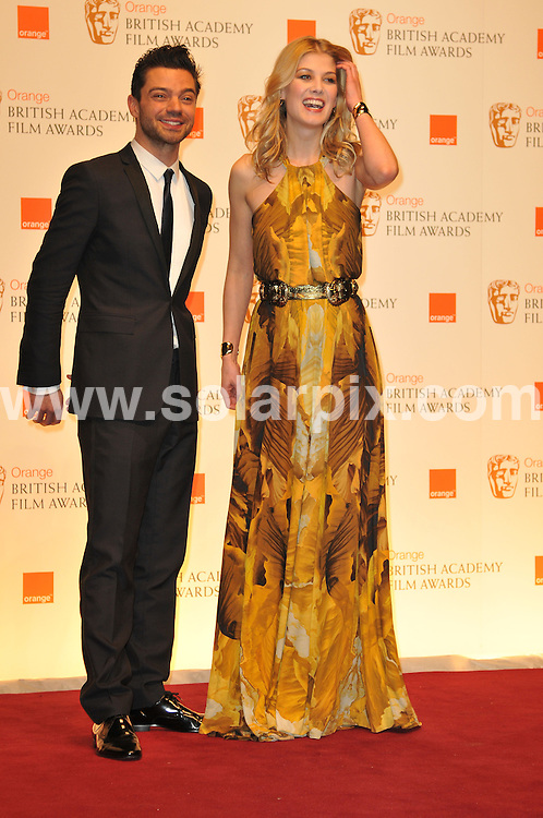 **ALL ROUND PICTURES FROM SOLARPIX.COM**                                             **WORLDWIDE SYNDICATION RIGHTS**                                                                                  Arrivals to the Orange British Academy Film Awards held at The Royal Opera House, London, UK. February 13, 2011                                                                            .This pic:   Rosamund Pike                                                                                   JOB REF:    12796    MSR       DATE:    13.02.11                                                        **MUST CREDIT SOLARPIX.COM OR DOUBLE FEE WILL BE CHARGED**                                                                      **MUST AGREE FEE BEFORE ONLINE USAGE**                               **CALL US ON: +34 952 811 768 or LOW RATE FROM UK 0844 617 7637**