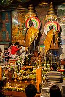 Cambodia, Siem Reap.  Worshipers Paying Homage to Thousand-year-old Statues of Angkorian Princesses Preah Ang Chek and Preah Ang Chorm.
