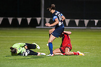 Kansas City, Mo. - Saturday April 23, 2016: FC Kansas City goalkeeper Nicole Barnhart (18) saves a shot by Portland Thorns FC midfielder Allie Long (10) at Swope Soccer Village. The match ended in a 1-1 draw.