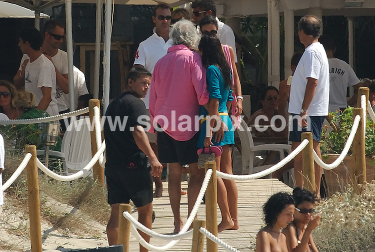**ALL ROUND PICTURES FROM SOLARPIX.COM**.**WORLDWIDE SYNDICATION RIGHTS EXCLUDING SPAIN - NO PUBLICATION IN SPAIN**.Formula One boss and Italian businessman Flavio Briatore and his recent new wife Elisabetta Gregaoraci headed over to the Spanish island of Ibiza this week, for a relaxing getaway with some family and friends including Alejandro Agag and Ana Aznar. ..This pic: Flavio Briatore and Elisabetta Gregaoraci..JOB REF: 7117 MAD       DATE: 25_08_2008.**MUST CREDIT SOLARPIX.COM OR DOUBLE FEE WILL BE CHARGED* *UNDER NO CIRCUMSTANCES IS THIS IMAGE TO BE REPRODUCED FOR ANY ONLINE EDITION WITHOUT PRIOR PERMISSION*