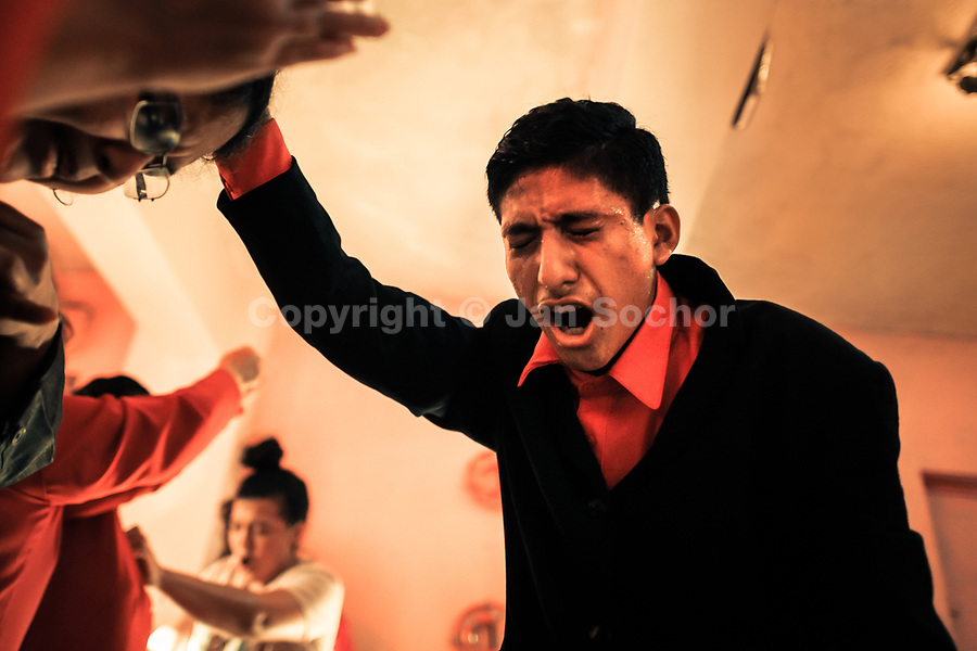 A Christian follower, a member of a local religious cult, screams during the religious exctasy in a home church in San Salvador, El Salvador, 25 November 2018. A small community of believers gathers every week in an unmarked home church to carry out prayers of liberation, invocations and the so-called evil expulsion rites. Reciting religious formulas through very loud speakers, using manipulative verbal techniques, intimidation and intense charisma, the leading pastor commands the supposed evil spirits to depart a devotee's mind and body which should bring to a devotee a spiritual relief.