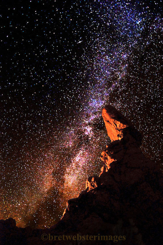 Special illumination and the Milky Way galaxy make an alien landscape out of Balanced Rock in Arches National Park, Utah.