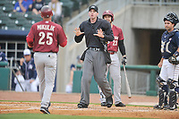 Home plate umpire Nate Tomlinson explains a call to Frisco RoughRiders manager Joe Mikulik (25) during the game against the Northwest Arkansas Travelers at Arvest Ballpark on May 23, 2017 in Springdale, Arkansas.  The RoughRiders defeated the Naturals 7-6 in the completion of the game suspended on May 23, 2017.  (Dennis Hubbard/Four Seam Images)