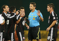 Kurt Morsink #6 and Jaime Moreno #99 of D.C. United argue with referee Alex Prus  during an MLS match against the San Jose Earthquakes at RFK Stadium in Washington D.C. on October 9 2010. San Jose won 2-0.