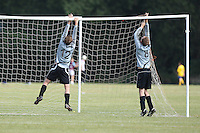 Players of Shoreditch Fire Penguins FC are seen taking down the goal nets after a Hackney & Leyton Sunday League match at Hackney Marshes - 20/09/09 - MANDATORY CREDIT: Gavin Ellis/TGSPHOTO - Self billing applies where appropriate - Tel: 0845 094 6026