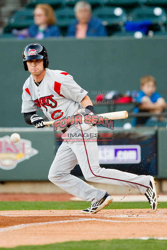 Tyler Naquin (6) of the Carolina Mudcats drops a bunt down the third base line during first inning action against the Winston-Salem Dash at BB&T Ballpark on April 13, 2013 in Winston-Salem, North Carolina.  The Dash defeated the Mudcats 4-1.  (Brian Westerholt/Four Seam Images)
