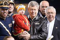 Pitt Chancellor Mark Nordenberg (holding child). The Miami Hurricanes defeated the Pitt Panthers 41-31 at Heinz Field, Pittsburgh, Pennsylvania on November 29, 2013.