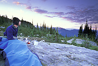 Backpacker in bivy sack, Mount Rainier National Park, Washington
