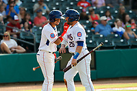 Tennessee Smokies catcher Tim Susnara (25) celebrates a run scored with Christopher Morel (11) during the game against the Rocket City Trash Pandas at Smokies Stadium on July 2, 2021, in Kodak, Tennessee. (Danny Parker/Four Seam Images)
