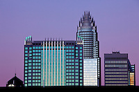 The Charlotte skyline takes on a pink-purple glow at dusk. C