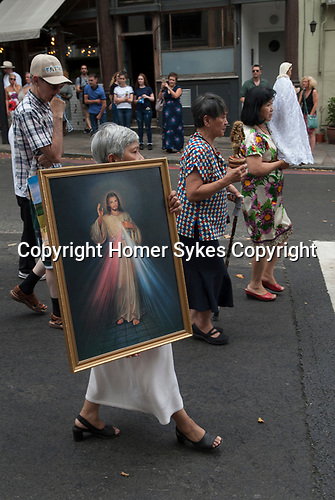 Filipino group take part in Italian community, annual procession starting from the Italian Church Saint St Peters London. 2018.