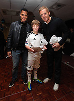 Pictured: Goalkeeper Michel Vorm (L) and Garry Monk (R) with young fan. Thursday 15 December 2011<br />