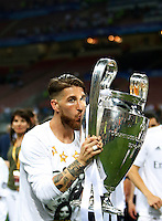 Calcio, finale di Champions League: Real Madrid vs Atletico Madrid. Stadio San Siro, Milano, 28 maggio 2016.<br /> Real Madrid's Sergio Ramos kisses the Champions League trophy at the end of the final match against Atletico Madrid, at Milan's San Siro stadium, 28 May 2016. Real Madrid won 5-4 on penalties after the game ended 1-1.<br /> UPDATE IMAGES PRESS/Isabella Bonotto