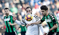 Calcio, Serie A: Sassuolo vs Juventus. Reggio Emilia, Mapei Stadium, 29 gennaio 2017. <br /> Juventus' Gonzalo Higuain, left, is challenged by Sassuolo's Luca Antei during the Italian Serie A football match between Sassuolo and Juventus at Reggio Emilia's Mapei stadium, 29 January 2017.<br /> UPDATE IMAGES PRESS/Isabella Bonotto
