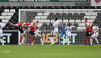 Pictured: Kirk Broadfoot of Rotherham (L) fails to score with a bicycle kick. Tuesday 26 August 2014<br />