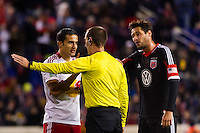 Tim Cahill (17) of the New York Red Bulls argues with referee Mark Geiger. D. C. United defeated the New York Red Bulls 1-0 (2-1 in aggregate) during the second leg of the MLS Eastern Conference Semifinals at Red Bull Arena in Harrison, NJ, on November 8, 2012.