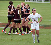NWA Democrat-Gazette/BEN GOFF @NWABENGOFF<br /> Carly Hoke of Arkansas walks off as Mississippi State celebrates their 2-1 victory on Sunday Sept. 20, 2015 during the match at Razorback Field in Fayetteville.