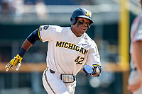 Michigan Wolverines designated hitter Jordan Nwogu (42) rounds third base headed home against the Texas Tech Red Raiders in the NCAA College World Series on June 21, 2019 at TD Ameritrade Park in Omaha, Nebraska. Michigan defeated Texas Tech 15-3 and will play in the CWS Finals. (Andrew Woolley/Four Seam Images)