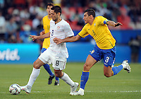 Clint Dempsey (8) of USA and Lucio (3) of Brazil. Brazil defeated USA 3-0 during the FIFA Confederations Cup at Loftus Versfeld Stadium in Tshwane/Pretoria, South Africa on June 18, 2009.