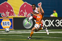 New York Red Bulls midfielder Dane Richards (19) gets a shot off past Houston Dynamo defender Wade Barrett (24). The New York Red Bulls defeated the Houston Dynamo 3-0 during a Major League Soccer match at Giants Stadium in East Rutherford, NJ, on August 24, 2008.