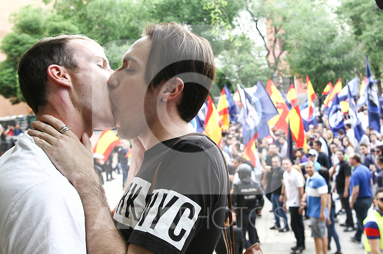 "Two gay guys give a kiss at the manifestation of far-right group , Hogar Social Madrid under the slogan "" Defend Spain , defend your people "", in the streets of Gran Via , San Bernardo and Plaza Dos de Mayo.  May 21, 2016. (ALTERPHOTOS/Rodrigo Jimenez)"