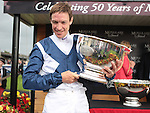 2012.09.09 - Horse Racing - The Curragh Racecourse - Moyglare Stud Stakes.Winning jockey Richard Hughes with the The Moyglare Stud Stakes Trophy at The Curragh Racecourse in Kildare, Ireland