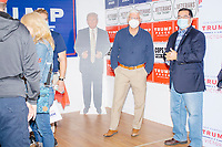 A cardboard cutout of US president Donald Trump stands in the corner near campaign signs during a Trump campaign office opening party in Salem, New Hampshire, on Fri., Sept. 18, 2020. Former 2016 Trump campaign manager and current 2020 Trump campaign senior advisor Corey Lewandowski, lives in nearby Windham, NH, spoke at the event, which also doubled as a surprise birthday celebration for Lewandowski.