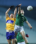 Cian O Dea of Clare  in action against Cormac Flanagan of Limerick during the Mc Nulty Cup U-21 final at The Gaelic Grounds. Photograph by John Kelly.