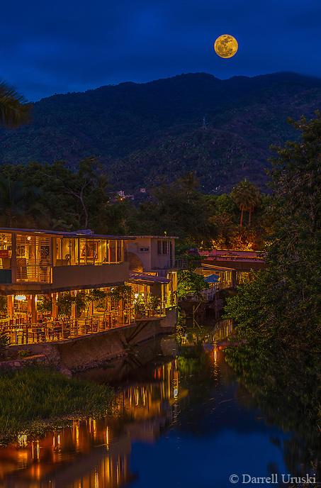 Fine Art Evening River Scenic of a full moon rising over the Rio Cuale in Puerto Vallarta, Mexico.