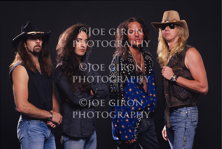 Portrait & live photographs of the band, Badlands.