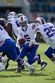 Buffalo Bills quarterback Tyrod Taylor (5) hands off to running back LeSean McCoy (25) during an NFL Wild-Card football game against the Jacksonville Jaguars, Sunday, January 7, 2018, in Jacksonville, Fla.  (Mike Janes Photography)