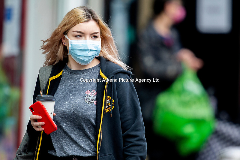 Pictured: A young lady walks down St Mary's Square, Swansea city centre, Wales, UK. Monday 28 September 2020<br /> Re: Local lockdown will be in force from 6pm on the 27th September 2020 due to the Covid-19 Coronavirus pandemic, in Swansea, Wales, UK.