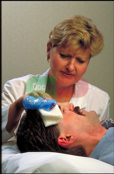 occupational nurse treats man with head wound