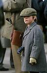 Like father like son, a young boy the Grand National horse race Aintree  Lancashire England