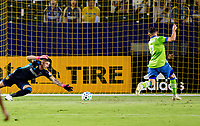 CARSON, CA - SEPTEMBER 27: Cristian Roldan #7 of the Seattle Sounders scores a goal past David Bingham #1 GK of the Los Angeles Galaxy during a game between Seattle Sounders FC and Los Angeles Galaxy at Dignity Heath Sports Park on September 27, 2020 in Carson, California.