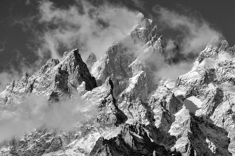 Peak of Teton Mountains with snow and clouds. Grand Teton National Park, WY